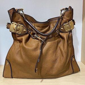- Miu Miu handbag or Tote